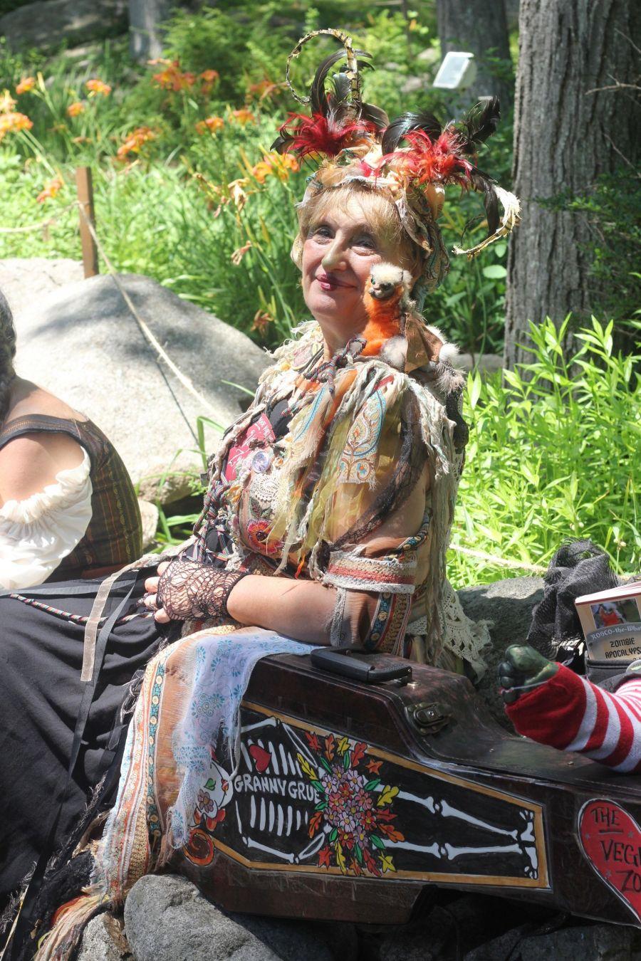gloucester hammond castle renaissance fair woman in feather outfit