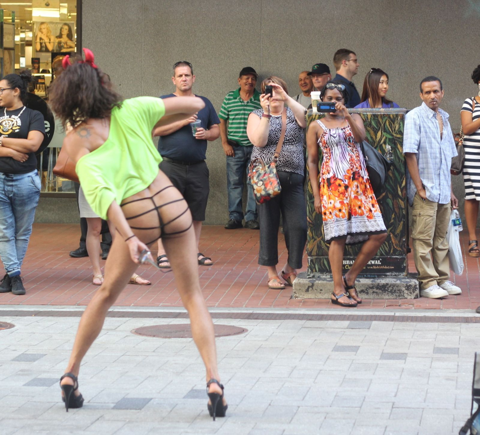 14b2555b6bb876 boston downtown crossing man in thong high heels singing dancing in front  of macy s 10