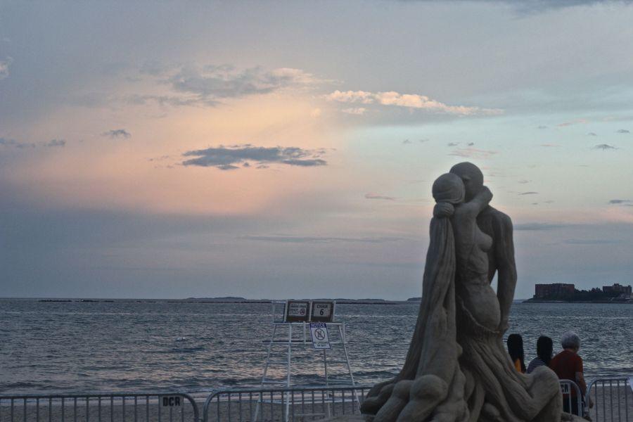 boston revere beach sand sculpture festival couple kissing statue sunset
