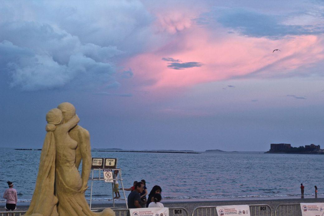 boston revere beach sand sculpture festival couple kissing sunset 3