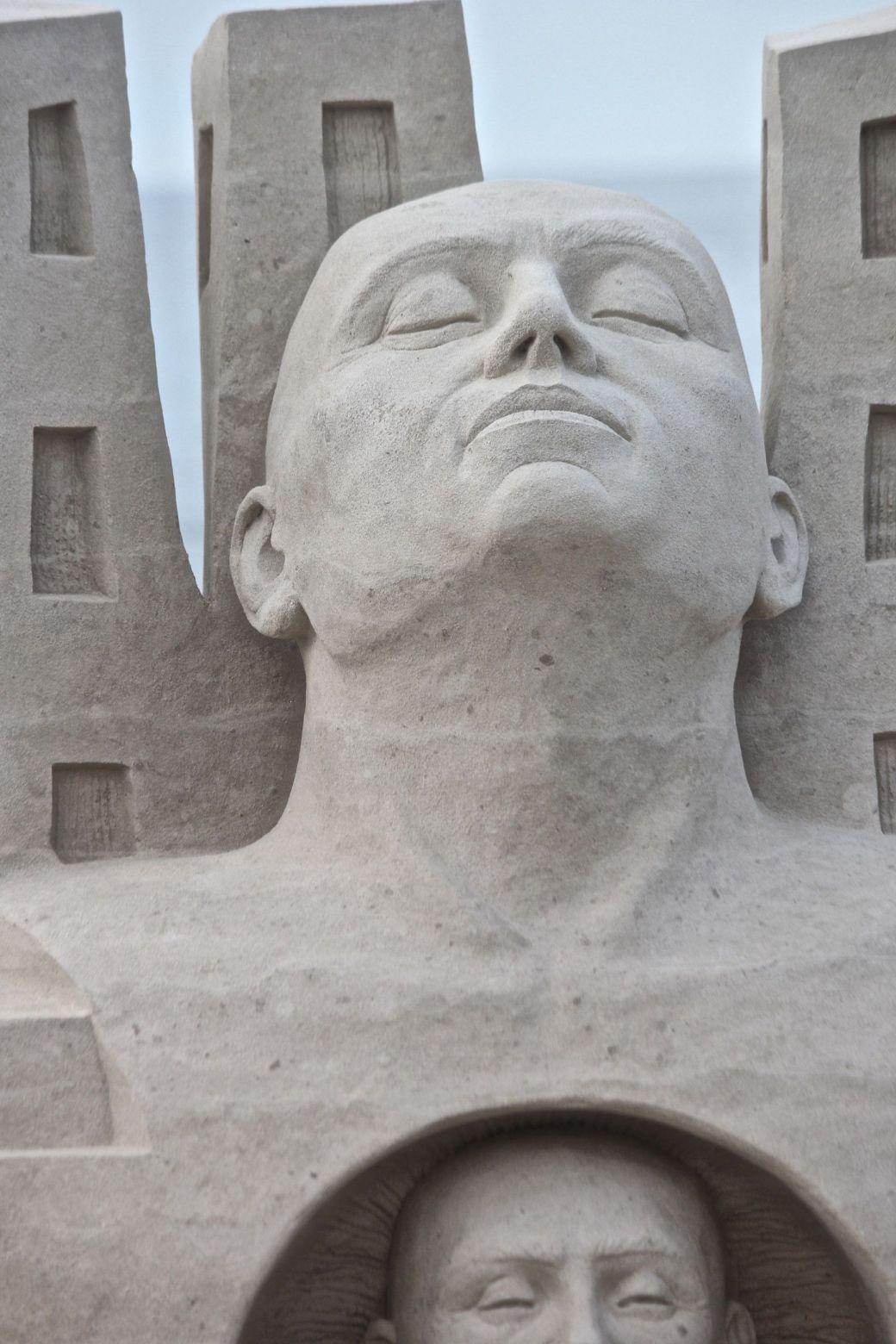 boston revere beach sand sculpture festival heads sculpture head