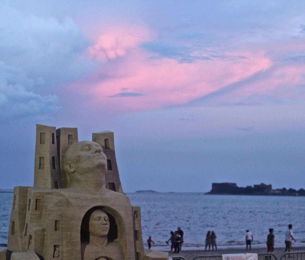 boston revere beach sand sculpture festival heads sculpture sunset