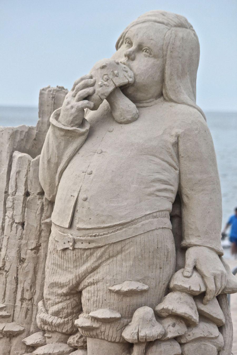boston revere beach sand sculpture festival kid eating mushroom