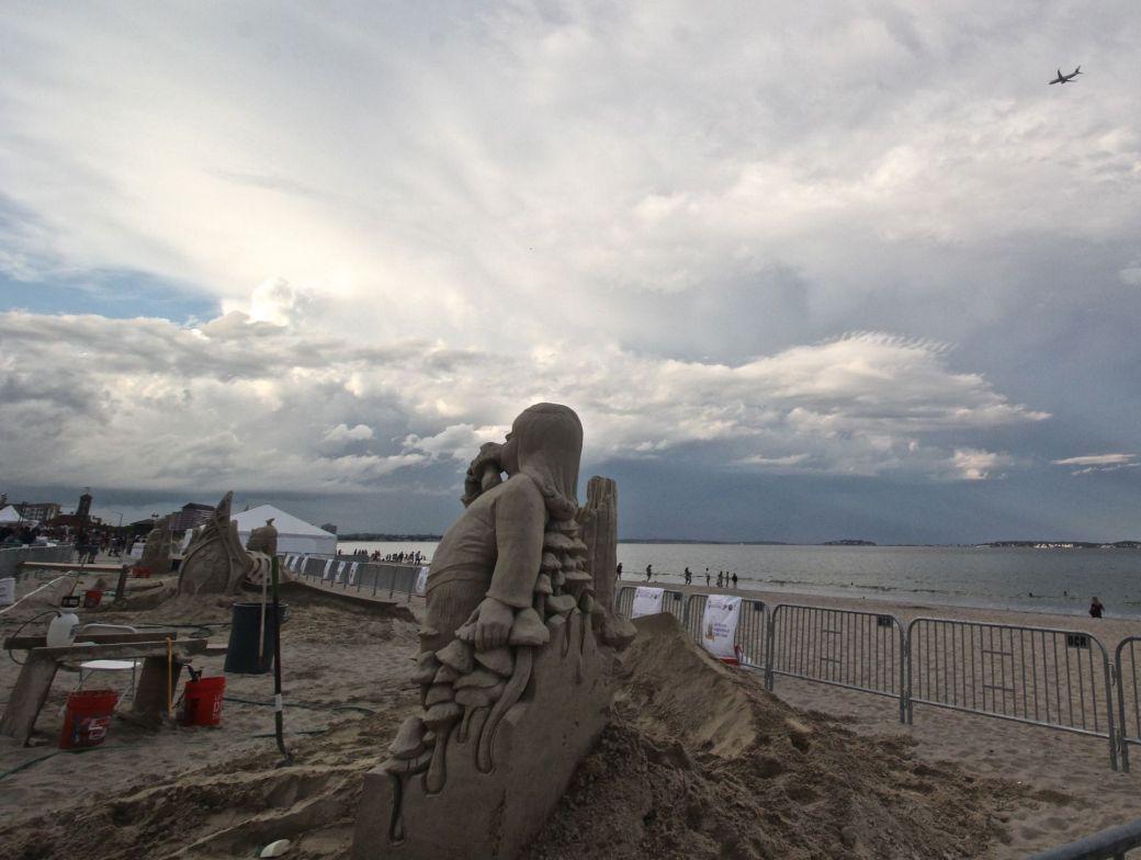 boston revere beach sand sculpture festival mushroom kid plane