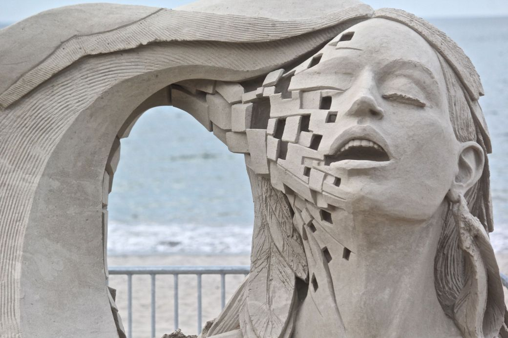 boston revere beach sand sculpture festival woman with wave