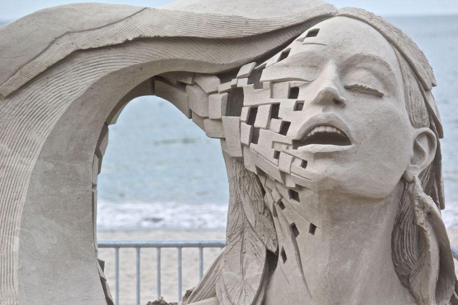 boston revere beach sand sculpture festival woman with wave