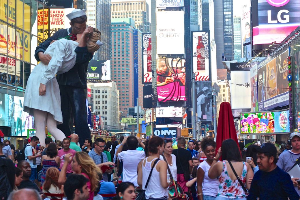 new york city times square embracing peace statue times square people