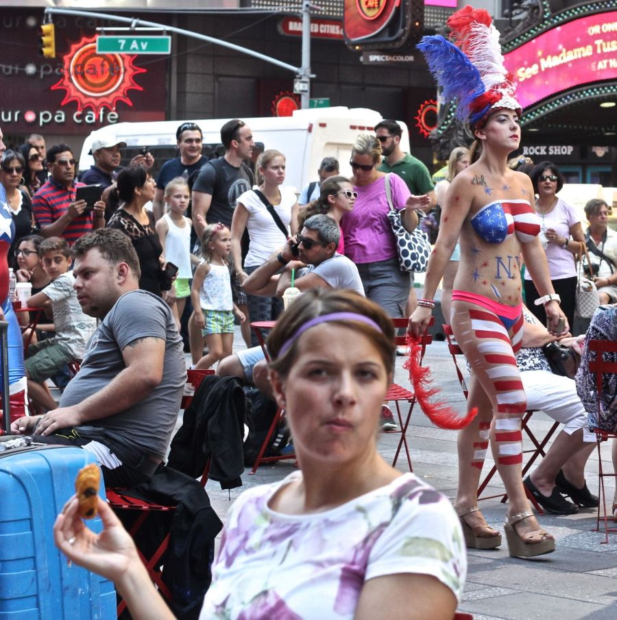 new york city times square naked painted woman walking through times square