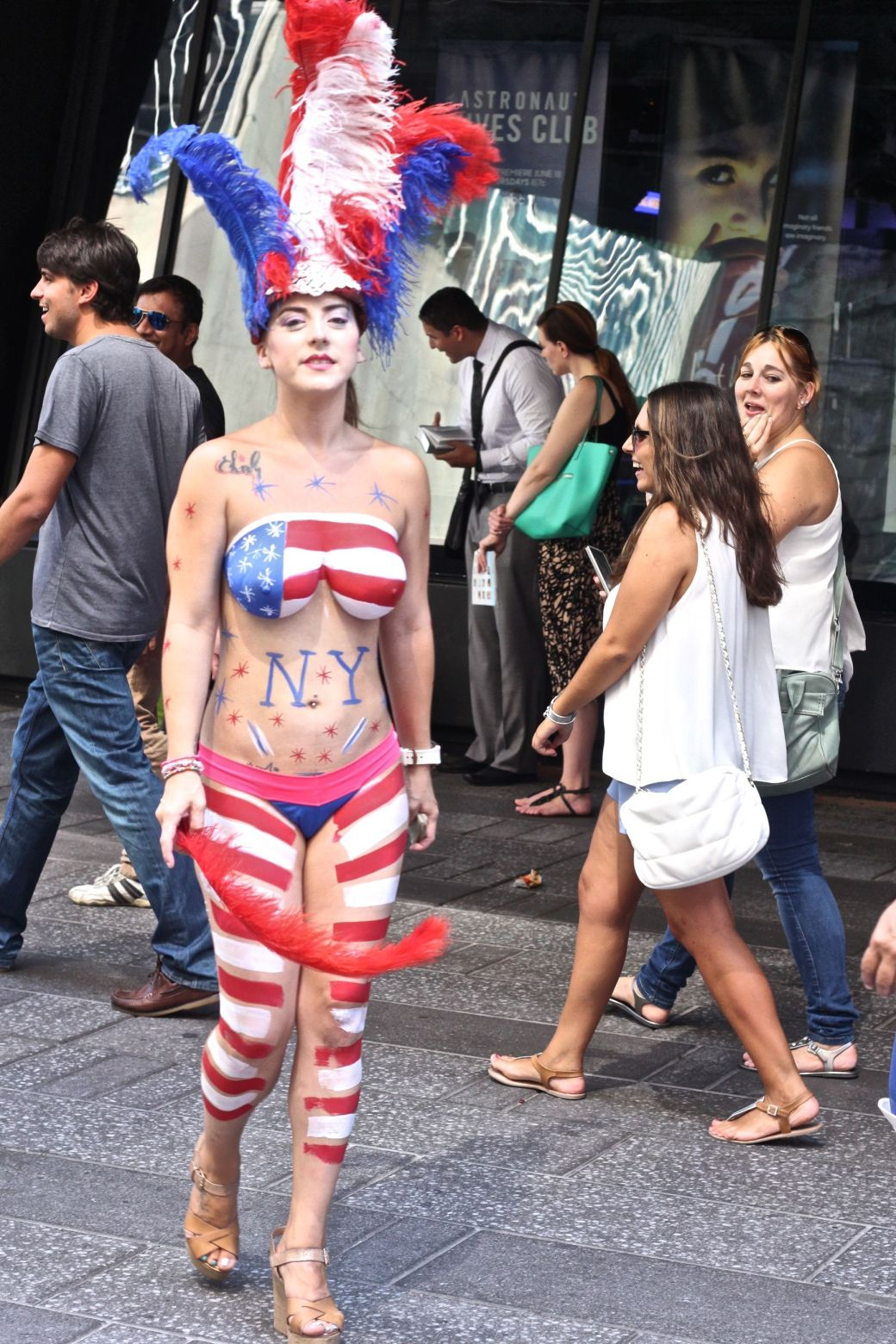 new york city times square naked painted woman with flag and feathers