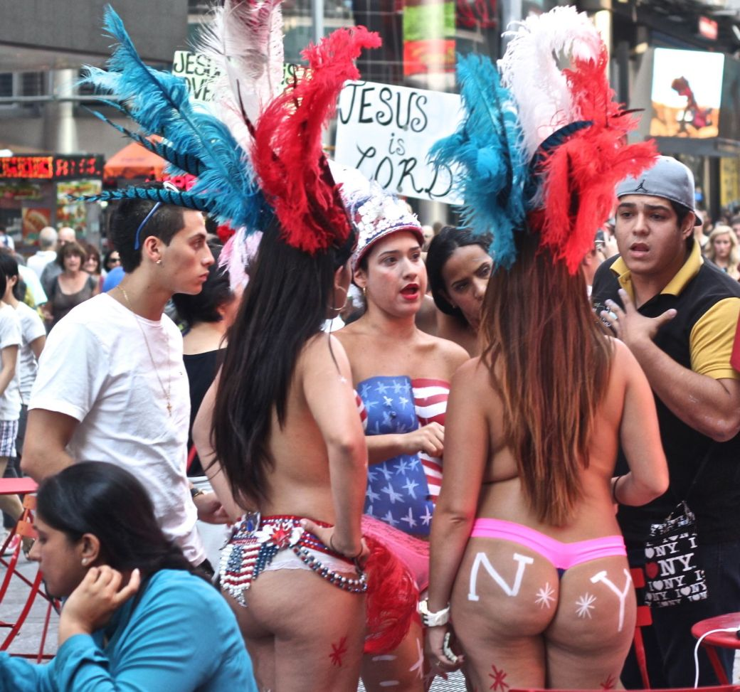 new york city times square naked painted women discussion jesus is lord sign background 2