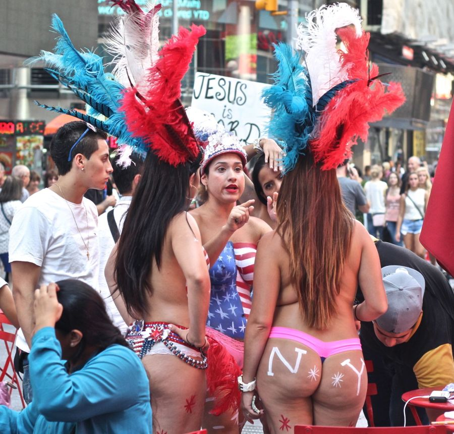 new york city times square naked painted women discussion jesus is lord sign background