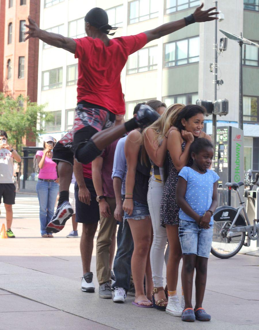 boston copley square street performer jumping