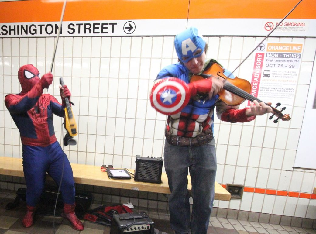 boston downtown crossing men dressed as spiderman and captain American playing violins 3