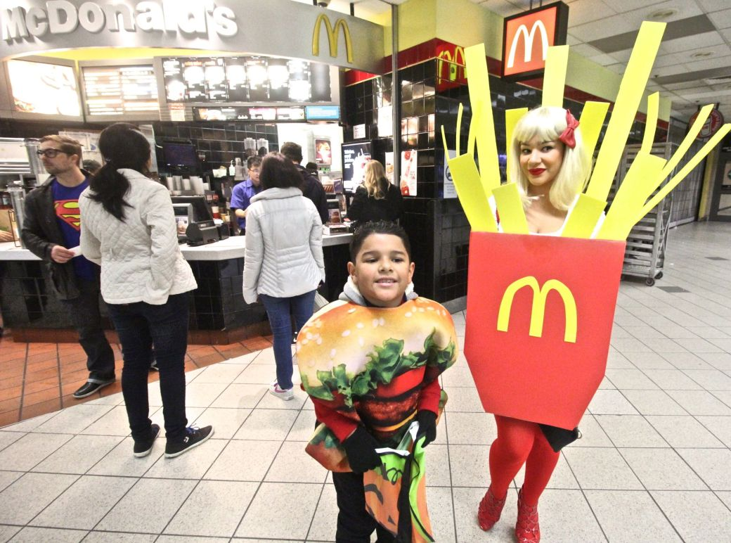 boston north station woman in fries costume in front of McDonalds