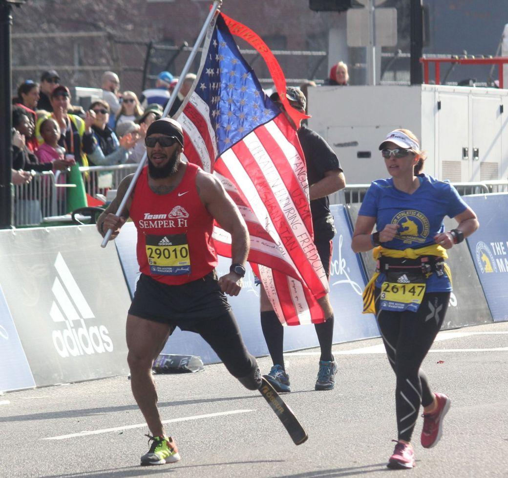 boston marathon april 18 2016 man with prosthetic limb American flag