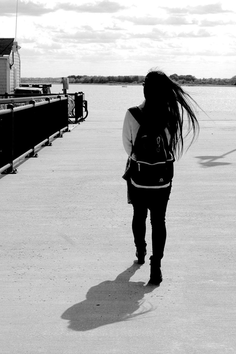 boston spectacle island girl walking