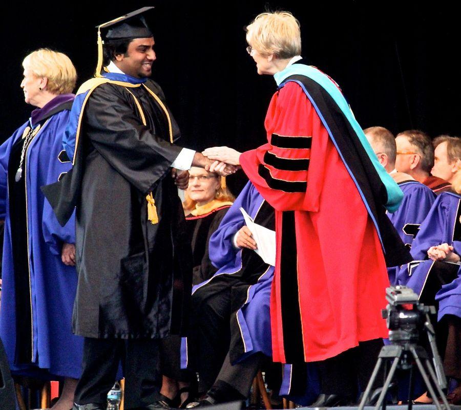 boston suffolk university graduation friend shaking hands with elizabeth warren