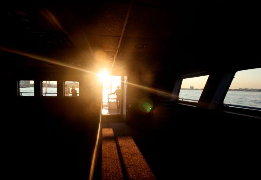 boston harbor boat inside sunset
