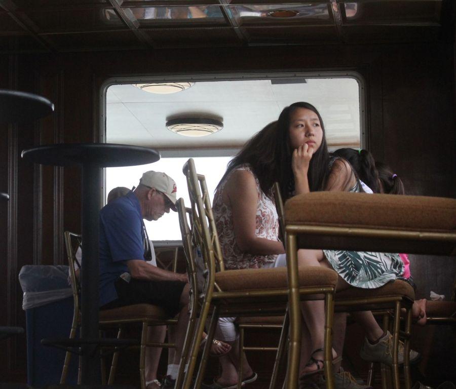 boston harbor cruise lounge person
