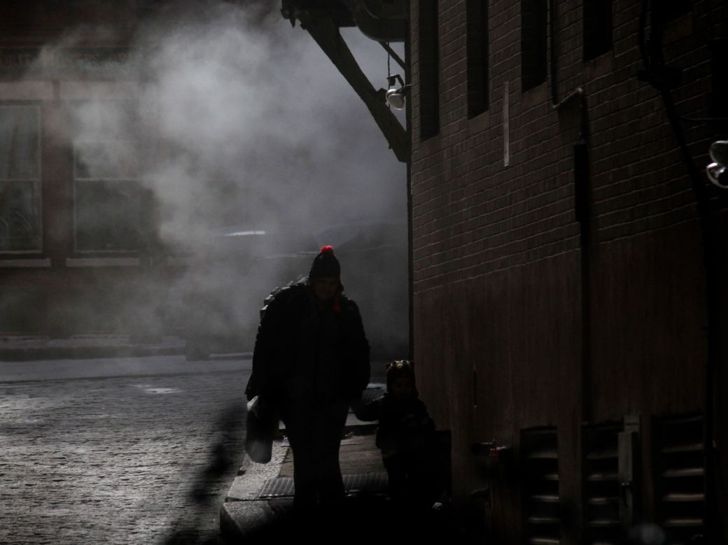 boston downtown man walking with child in steam 2