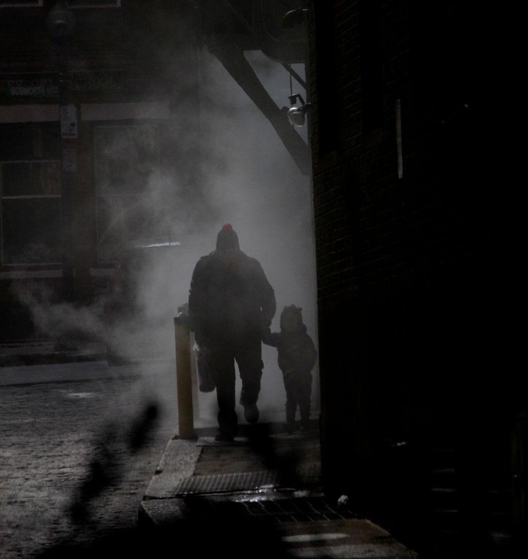 boston downtown man walking with child in steam 3