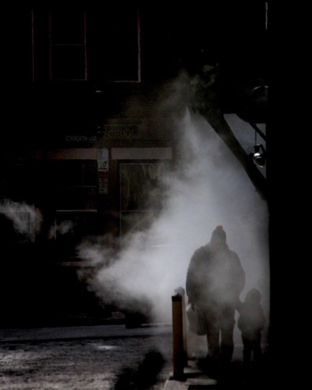 boston downtown man walking with child in steam