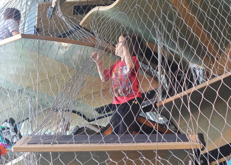 boston childrens museum child on climbing thing