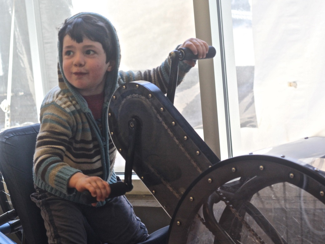 boston childrens museum child on hand bike