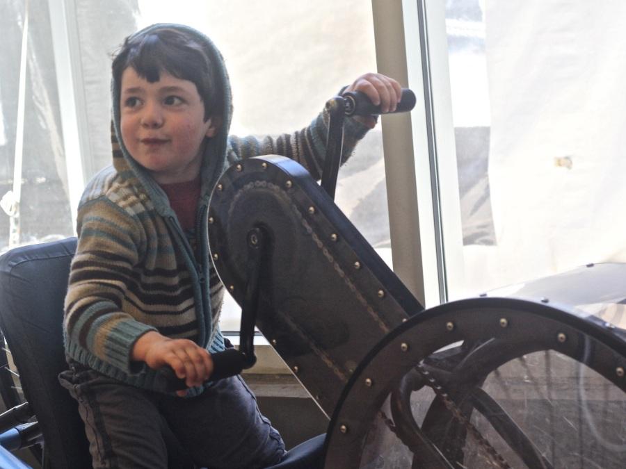 boston childrens museum child on hand bike