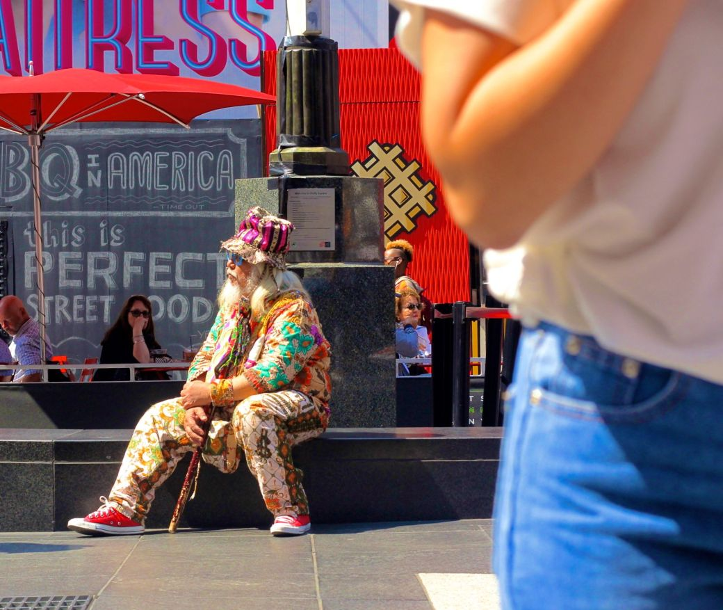 new york city times square man in colorful outfit