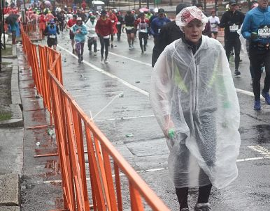boston marathon april 16 2018 woman rain coat