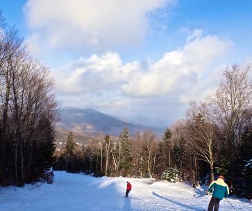 bretton woods ski resort clouds blue sky skiers